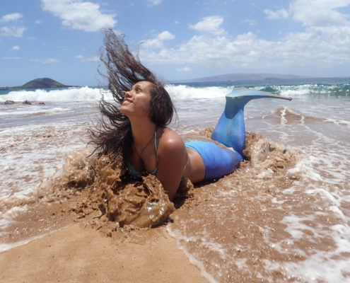 mermaid in Maui with ocean splash
