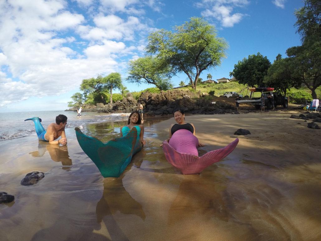 green pink mermaids blue merman beach