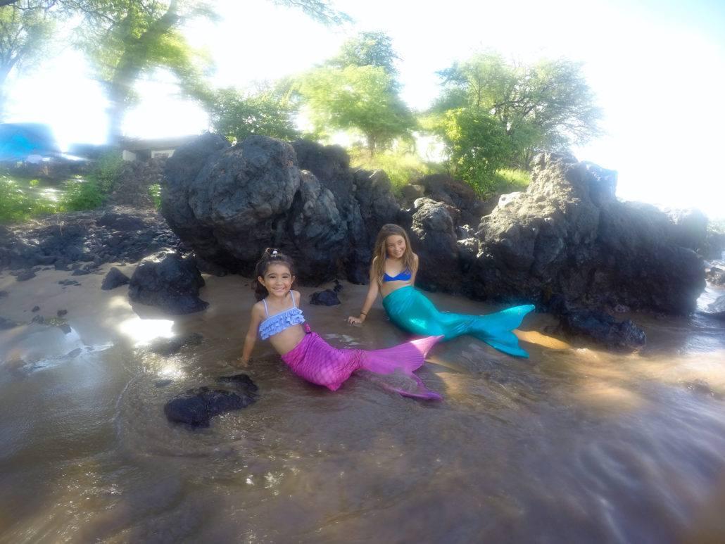 pink green mermaids beach water