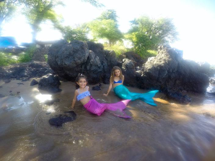 pink green mermaids beach water